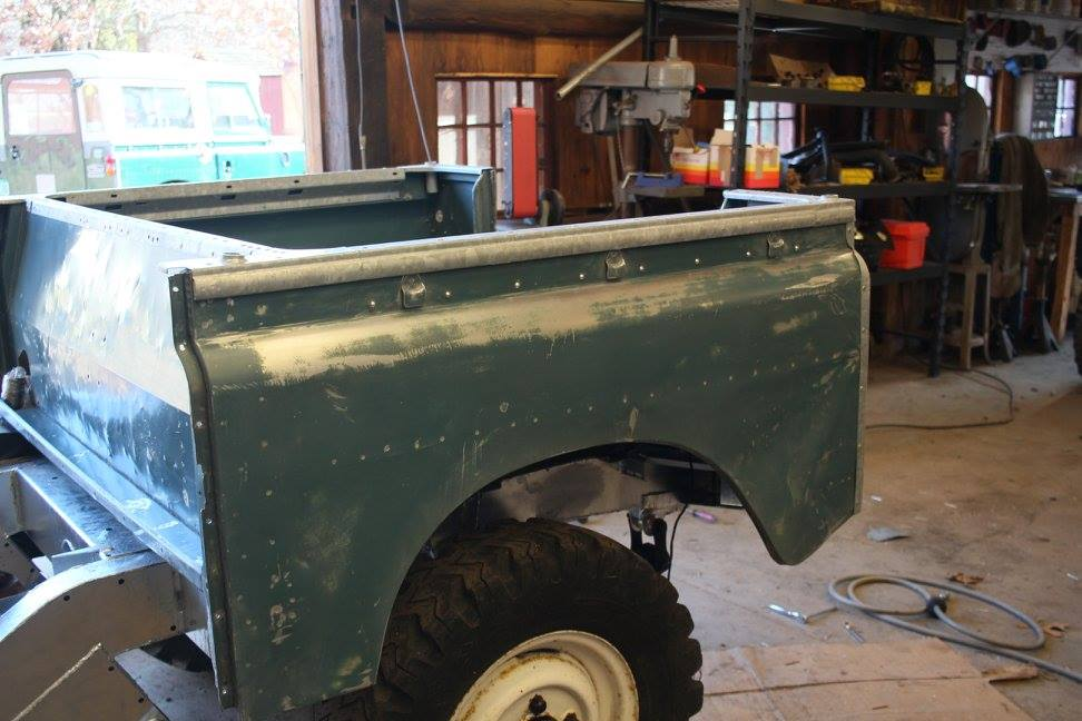 The rear tub is installed on the frame. The cappings were re-galvanized and reinstalled with the correct hammer rivets.
