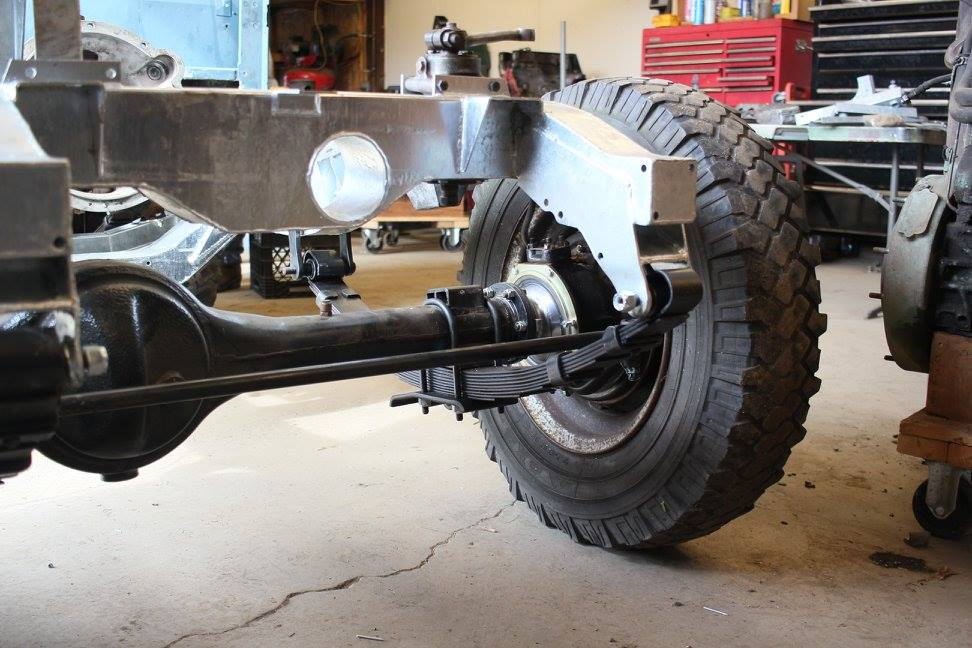 The refurbished front axle is installed in a new galvanized frame with new springs.