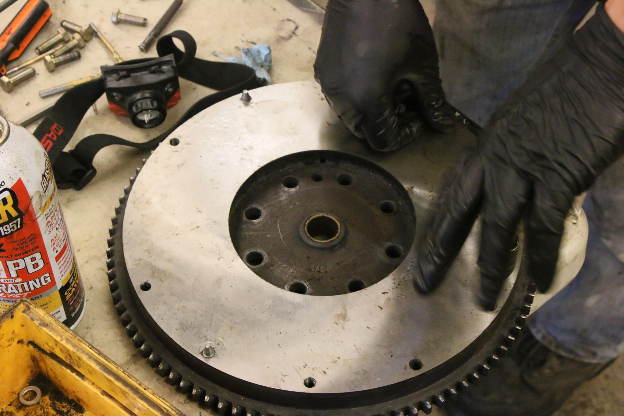 A flywheel for a 9.5 inch clutch is sourced and resurfaced.