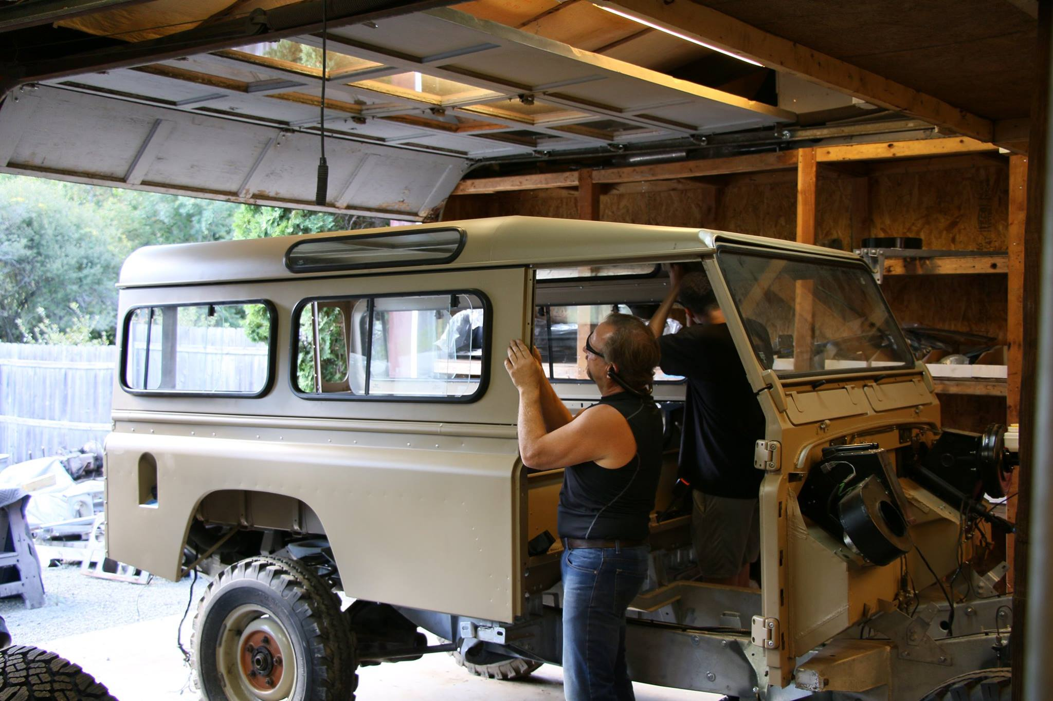 New side panels with genuine Land Rover sliding windows.