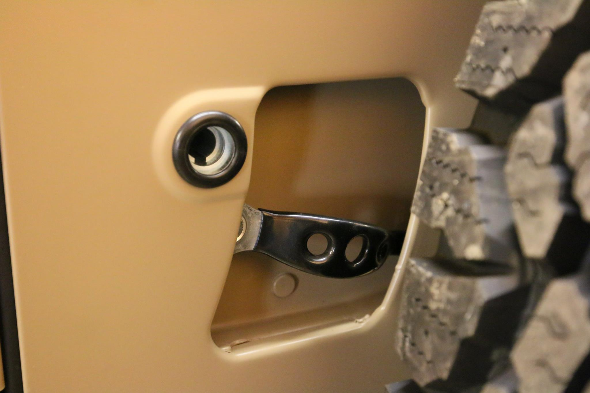Genuine door latch handle.