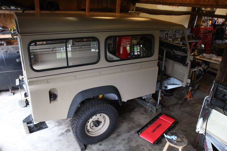 The roof and side panels are installed. The side panels have genuine Land Rover Africa spec windows.
