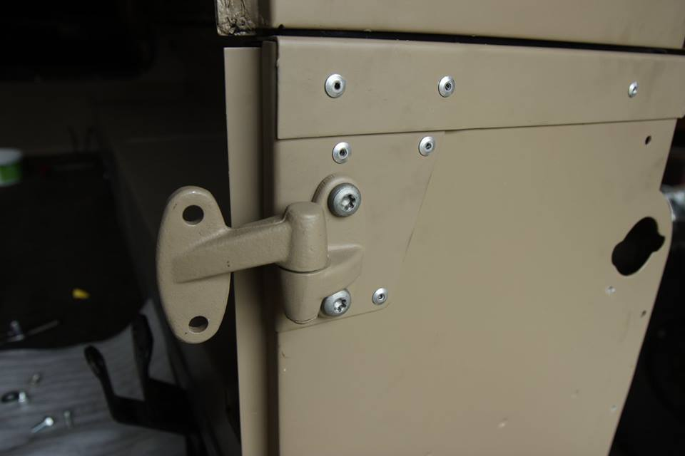All cappings are riveted just like they would have from the factory. Also, new genuine Land Rover rust resistant door hinges are installed with galvanized hardware.