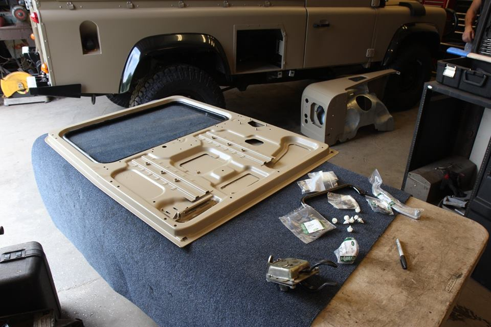 A new genuine Land Rover Puma rear door is assembled. Unlike the original doors, these doors are galvanized steel.