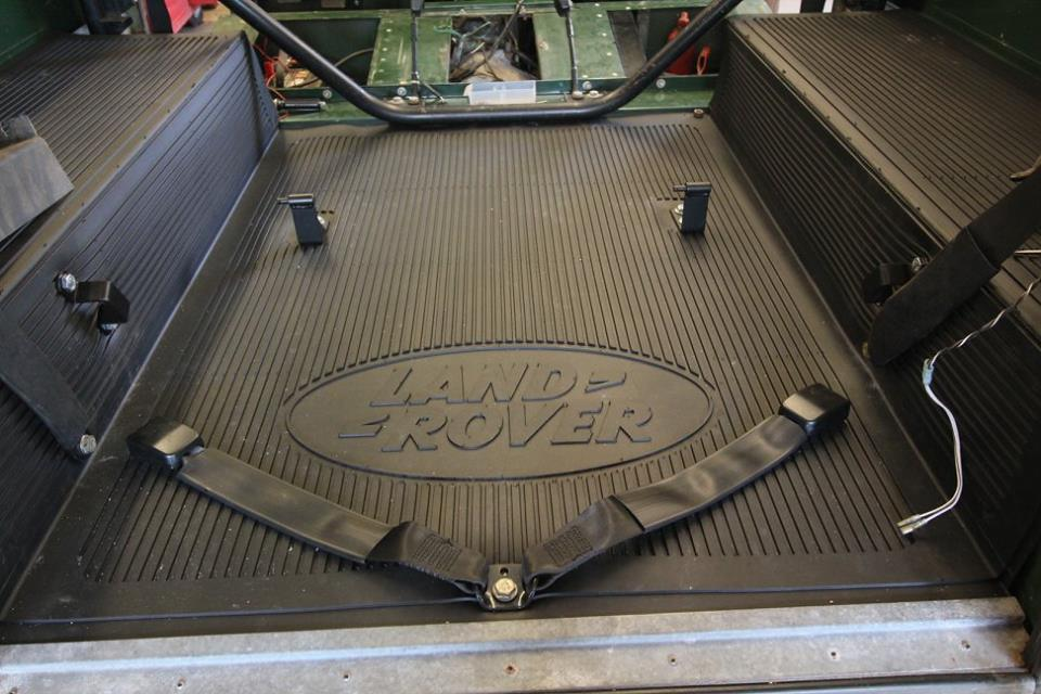A new genuine Land Rover rear mat is installed.