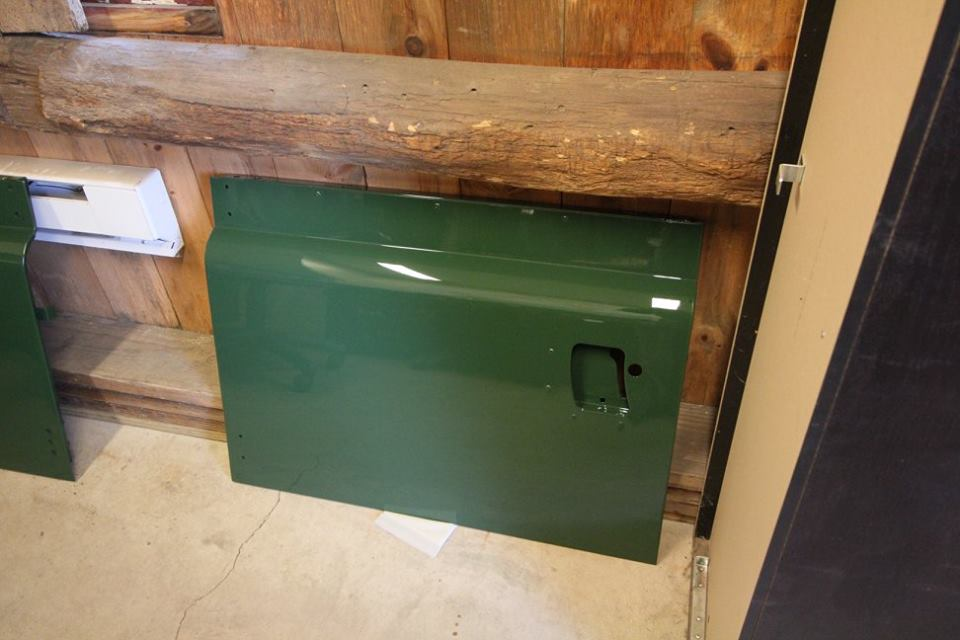 New genuine Land Rover doors are repainted in Conniston Green Glasurit.