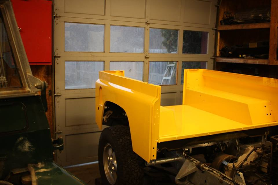 The body panels were stripped to bare aluminum and repainted in AA Yellow Glasurit which is an extremely high quality paint.