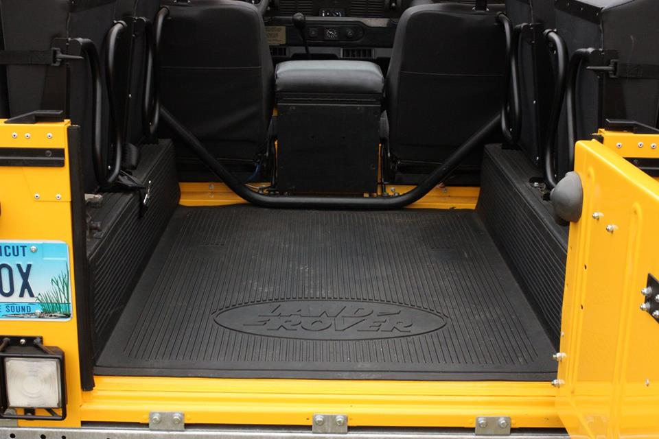 A new genuine Land Rover rear floor mat is installed.