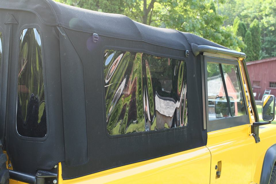 Unlike the original soft top, this one has a full gutter kit around the doors to keep rain and wind out. It also has tinted windows and roll up sides.