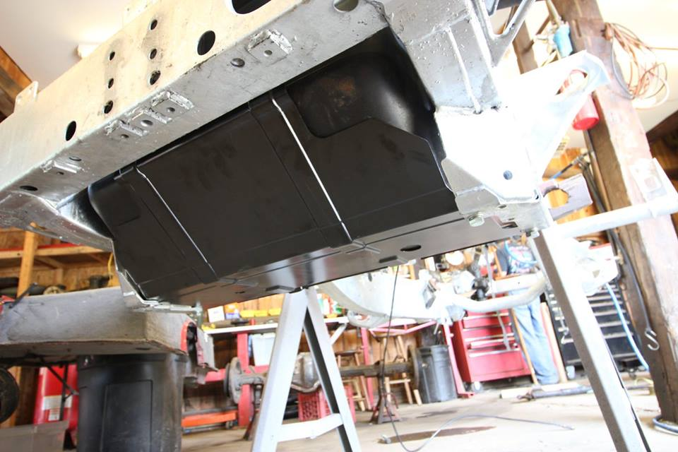 A new genuine Land Rover gas tank skid plate is installed.