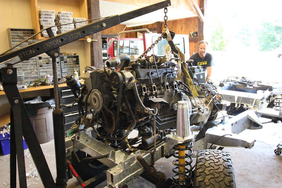 The drivetrain is reinstalled into the rolling chassis.