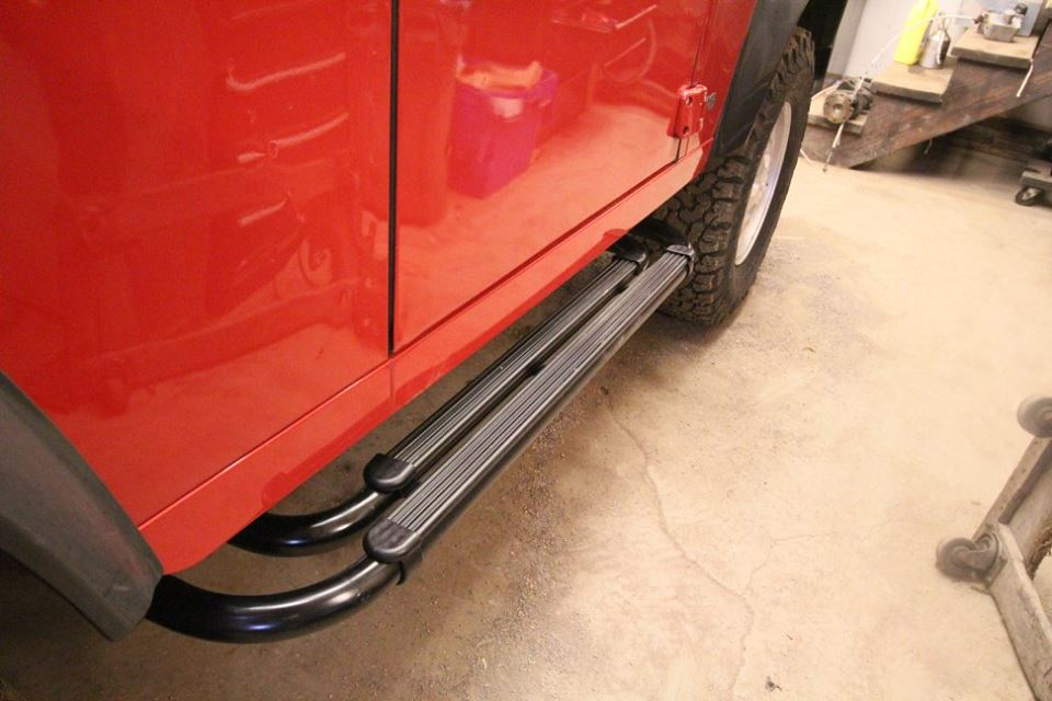 New genuine Land Rover side steps are installed.